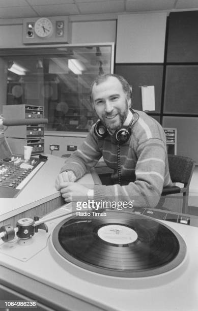 Portrait of radio host Ken Bruce in the studio photographed for Radio Times in connection with his self titled BBC Radio 2 show January 1984 First...
