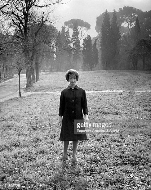 Portrait of RAI announcer and presenter Aba Cercato who poses in the middle of a meadow in a hazy atmosphere December 1961