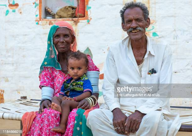 Portrait of rajasthani couple with their child Rajasthan Jaisalmer India on July 22 2019 in Jaisalmer India