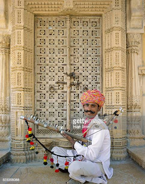 portrait of rajasthani musician - hugh sitton india stock pictures, royalty-free photos & images