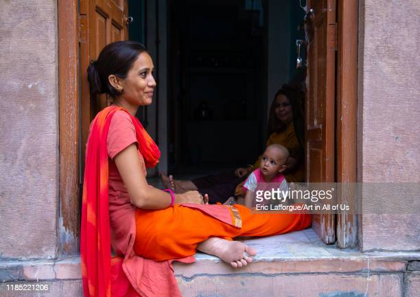 Portrait of rajasthani woman with her toddler Rajasthan Jodhpur India on July 19 2019 in Jodhpur India