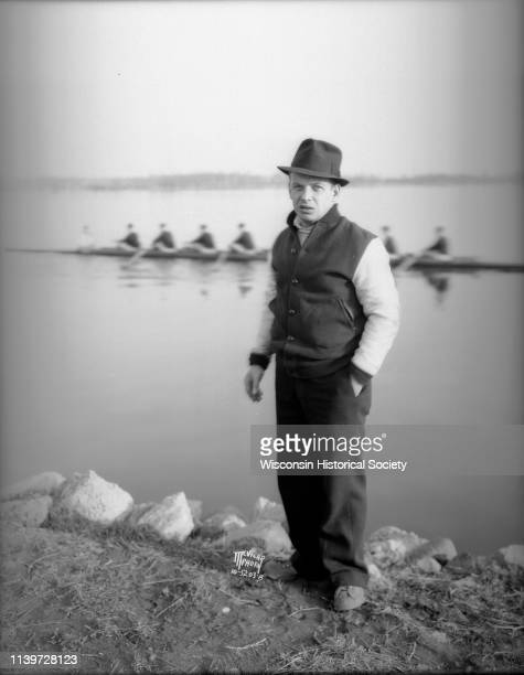 Portrait of Ralph Hunn coach of the University of WisconsinMadison crew standing on the shoreline of Lake Wingra Madison Wisconsin April 18 1935 In...
