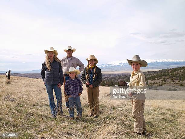 Portrait of ranch family outdoors