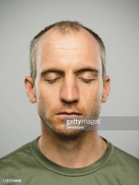 portrait of real caucasian man with blank expression and eyes closed - eyes closed stock pictures, royalty-free photos & images