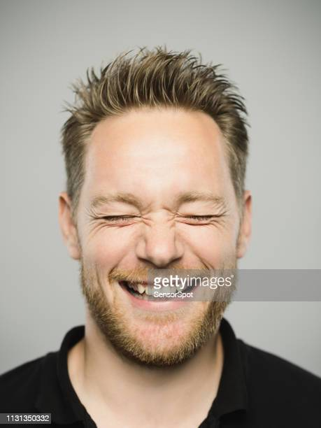 portrait of real caucasian man with excited expression and closed eyes - eyes closed stock pictures, royalty-free photos & images