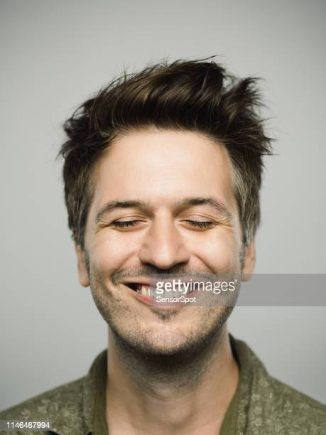 portrait of real caucasian man with excited expression and eyes closed - cheio imagens e fotografias de stock