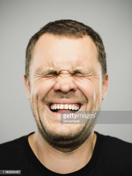 portrait of real caucasian man with excited expression and eyes closed - toothy smile stock pictures, royalty-free photos & images