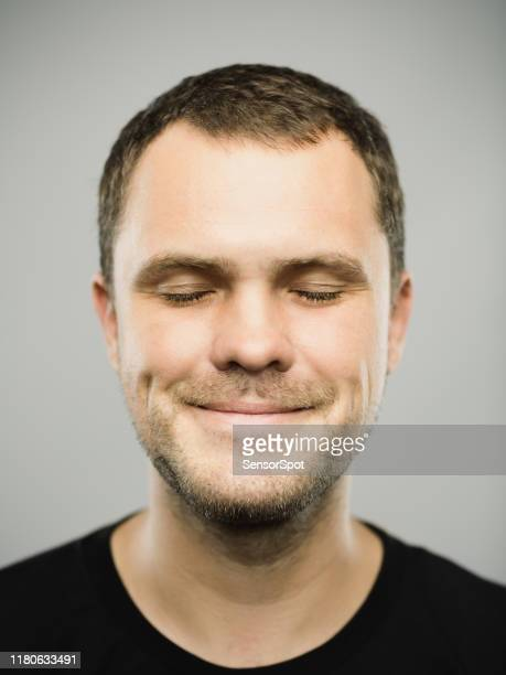 portrait of real caucasian man with happy expression and eyes closed - zen like stock pictures, royalty-free photos & images
