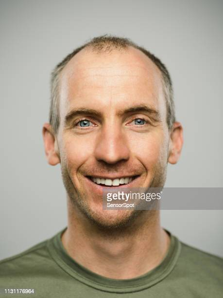portrait of real caucasian man with happy expression looking at camera - army stock pictures, royalty-free photos & images