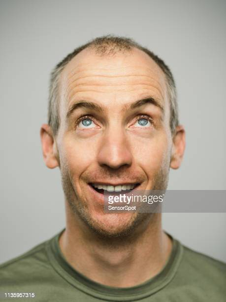 portrait of real caucasian man with surprised expression looking up - hair loss stock pictures, royalty-free photos & images