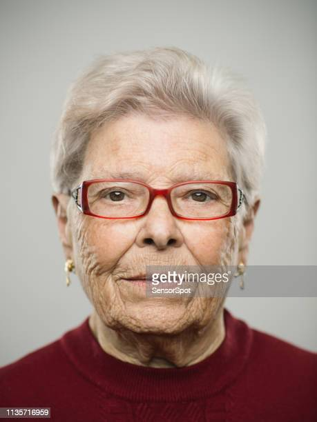 portrait of real caucasian senior woman with blank expression - police mugshot stock pictures, royalty-free photos & images