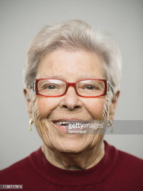 portrait of real caucasian senior woman with happy expression - dentures stock pictures, royalty-free photos & images