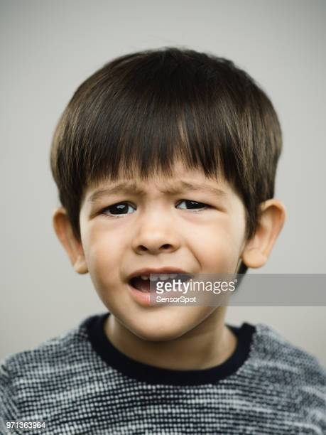 Portrait of real disgusted kid