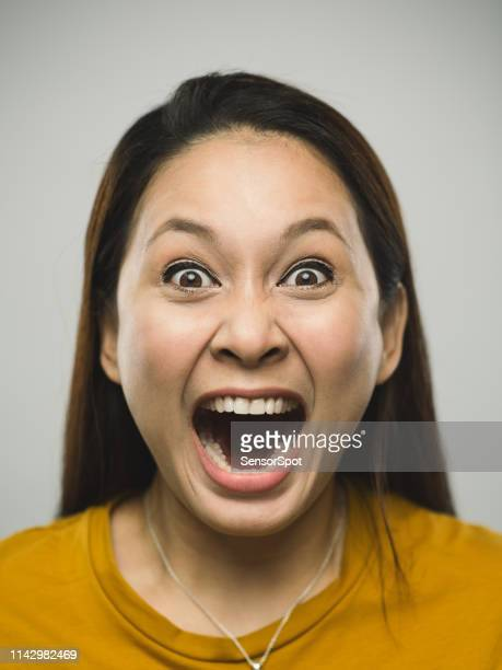 portrait of real malaysian young woman with shouting expression - insanity stock pictures, royalty-free photos & images