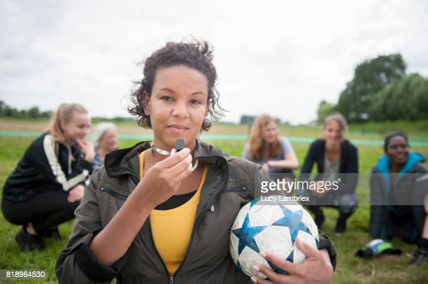 portrait of recreational female soccer player - female umpire stockfoto's en -beelden