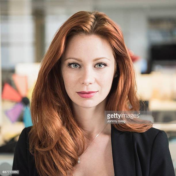 Portrait of red haired businesswoman