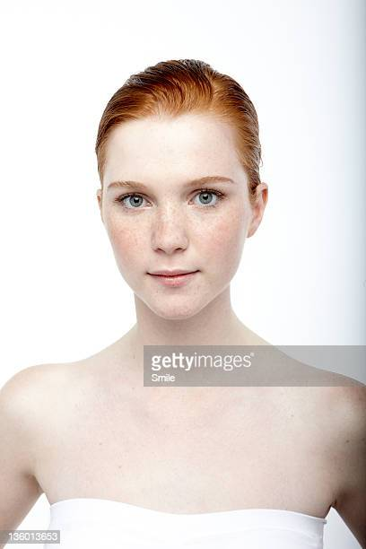 Portrait of redhead girl with hair gelled back
