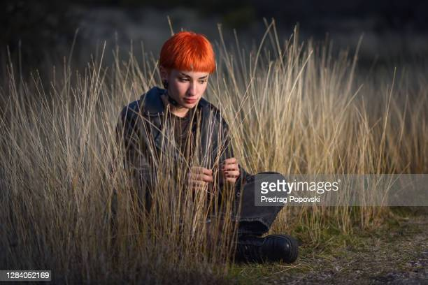 portrait of redhead teenage girl - dyed red hair stock pictures, royalty-free photos & images