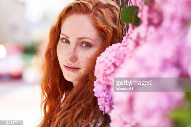 portrait of redheaded woman with freckles - wishful skin stock pictures, royalty-free photos & images