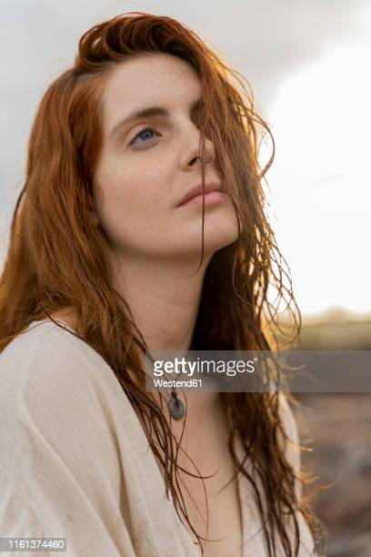portrait of redheaded young woman with nose piercing - wishful skin stock pictures, royalty-free photos & images