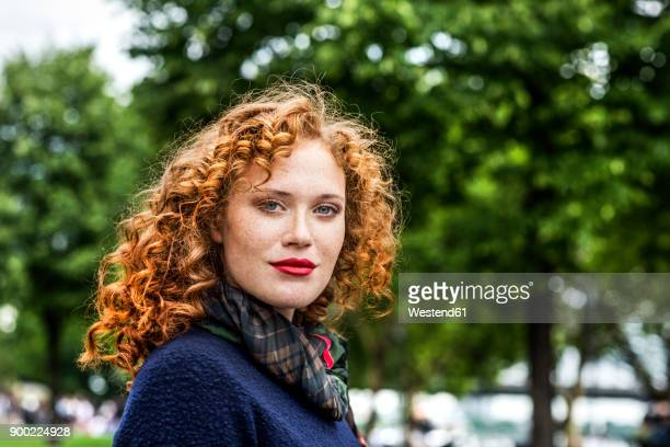 portrait of redheaded young woman with red lips - hair colour stock pictures, royalty-free photos & images