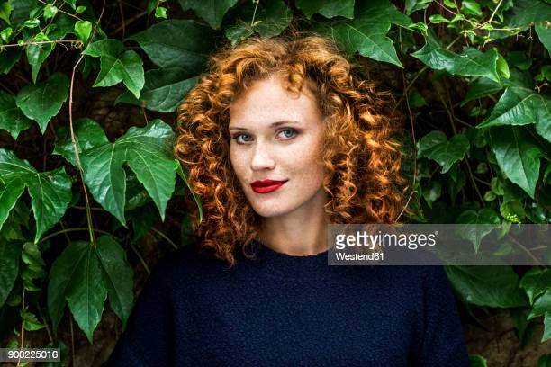 portrait of redheaded young woman with red lips - curly hair stock pictures, royalty-free photos & images