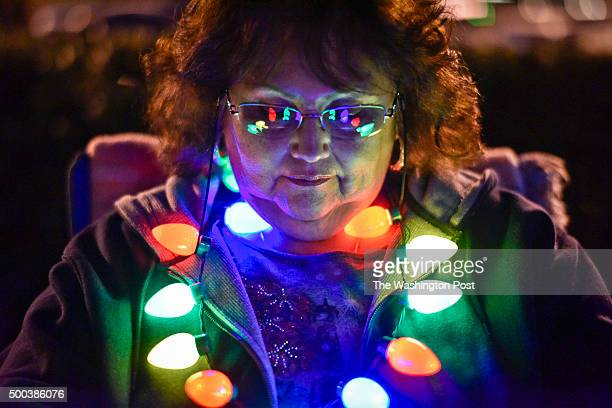 Portrait of Redlands resident Gloria Lerma waiting before the start of the 2015 Redlands Christmas parade Saturday night in downtown Redlands, CA....