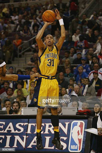 Portrait of Reggie Miller of the Indiana Pacers shoots over Rasheed Wallace of the Detroit Pistons in Game four of the Eastern Conference Finals...