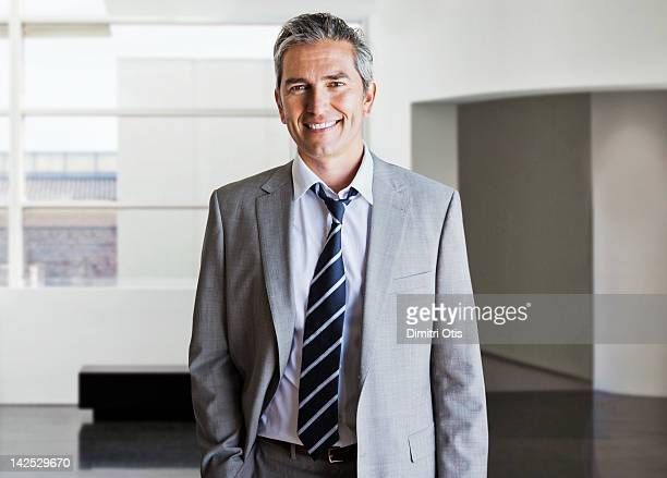 Portrait of relaxed businessman in modern interior