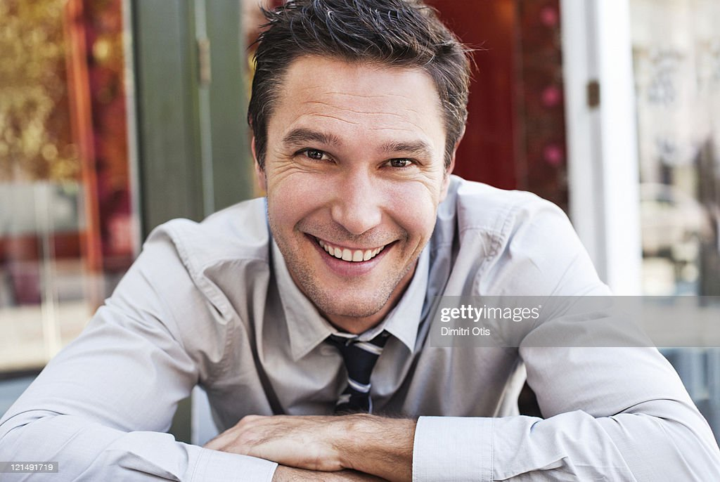 Portrait of relaxed businessman in suit, smiling : Stock Photo