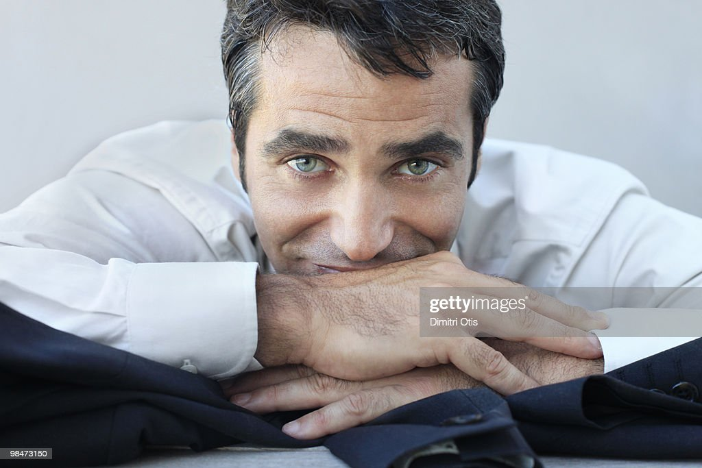 Portrait of relaxed businessman : Stock Photo