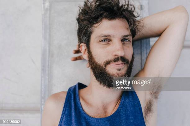 portrait of relaxed man lying in skatepark - male armpits stock pictures, royalty-free photos & images
