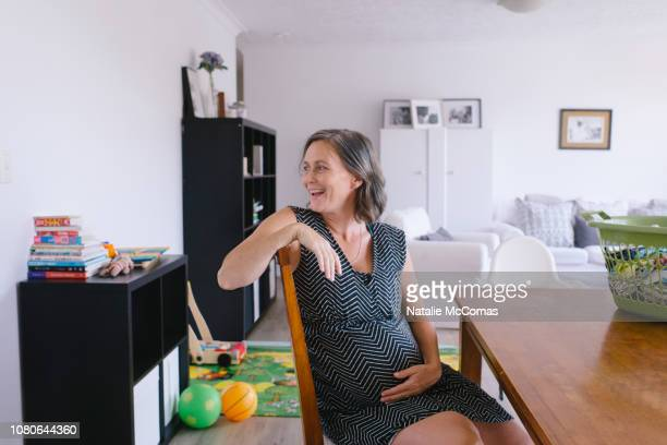 Portrait of relaxed mature pregnant at home