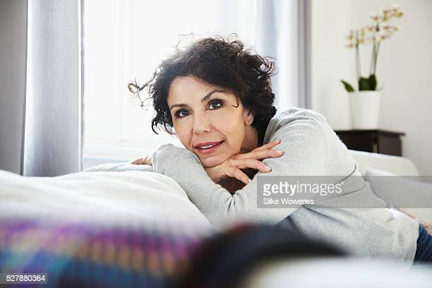 Portrait of relaxed woman in living room