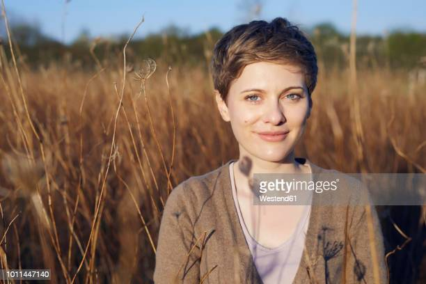 portrait of relaxed woman in nature - short hair stock pictures, royalty-free photos & images