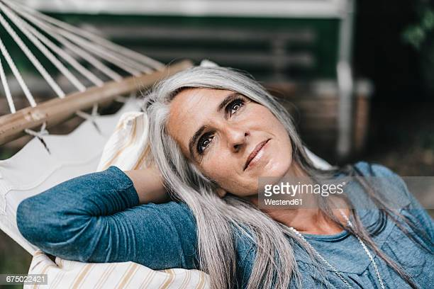 Portrait of relaxed woman lying in a hammock