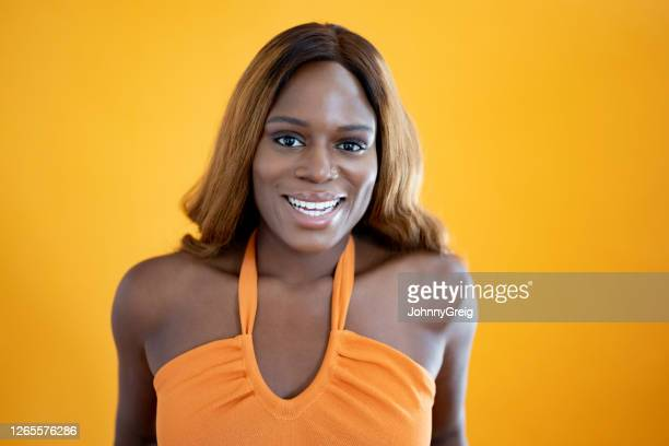 portrait of relaxed young black woman with long brown hair - sleeveless stock pictures, royalty-free photos & images