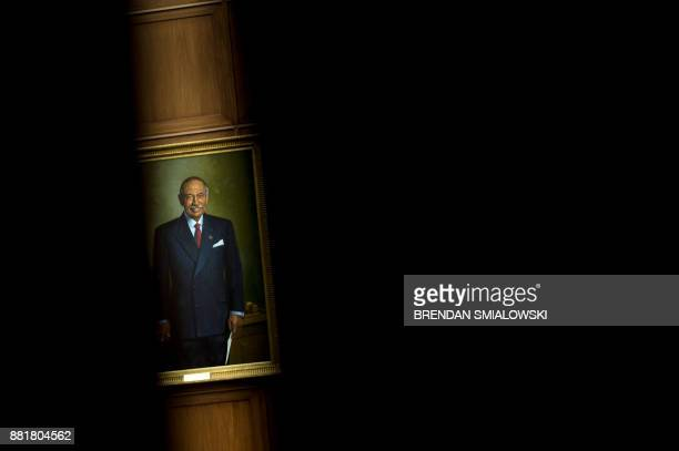 A portrait of Rep John Conyers a former committee chairman is seen in the House Judiciary Committee Room on Capitol Hill November 29 2017 in...