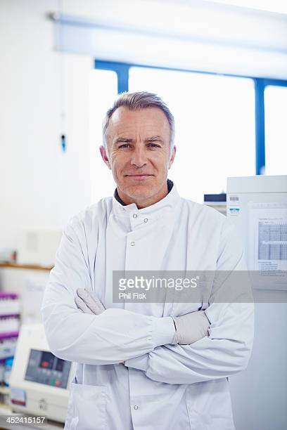 Portrait of researcher standing in lab wearing lab coat