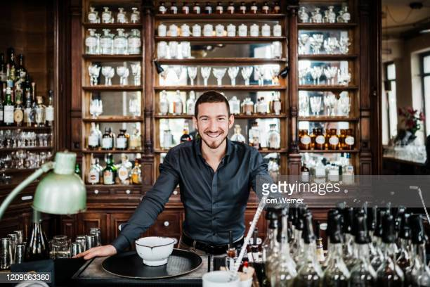 portrait of restaurant bar tender - black shirt stock pictures, royalty-free photos & images