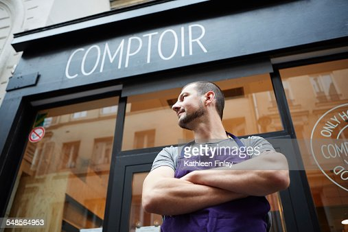 Portrait of restaurant owner, outside his business, low angle view