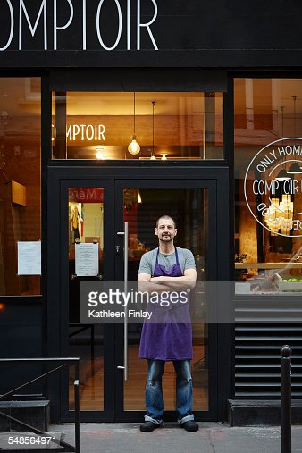 Portrait of restaurant owner, outside his business