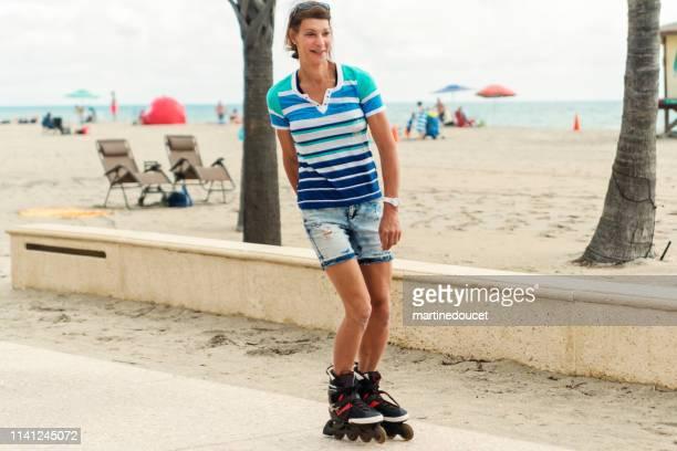 "portrait of retired trans woman rollerskating near beach. - ""martine doucet"" or martinedoucet bildbanksfoton och bilder"
