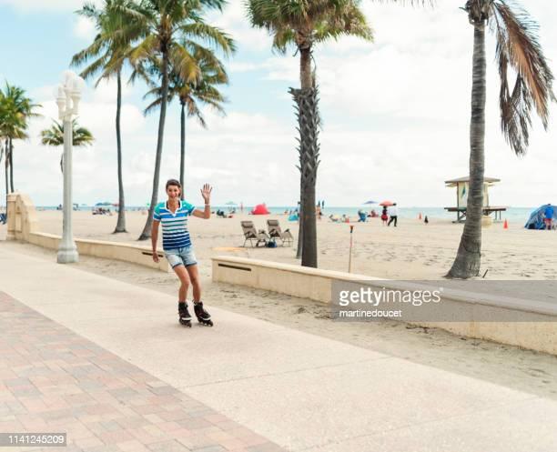portrait of retired trans woman rollerskating near beach. - フロリダ州ハリウッド ストックフォトと画像