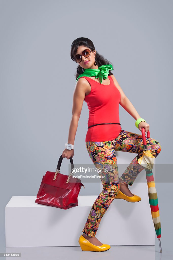 Portrait of retro woman with hand bag and umbrella : Stock Photo
