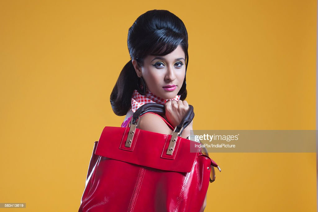 Portrait of retro woman with hand bag : Stock Photo