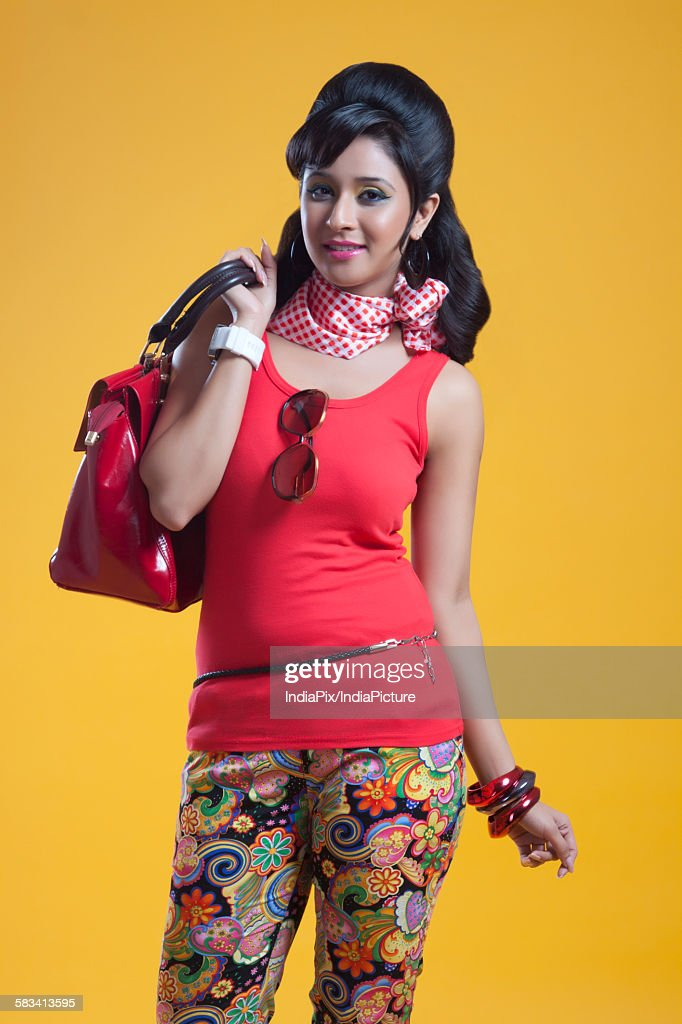 Portrait of retro woman with hand bag smiling : Stock Photo