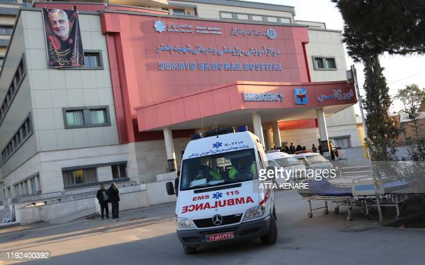 A portrait of Revolutionary Guards commander Qasem Soleimani hangs on the wall of a hospital in the southeastern Iranian city of Kerman where a...