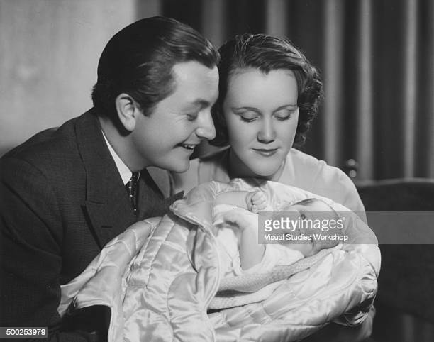 Portrait of Robert Young an American television film and radio actor with wife and baby 1942