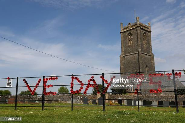A portrait of Robinson Collins is displayed outside Holy Trinity Church to commemorate VE Day on May 08 2020 in Binegar Somerset United Kingdom The...